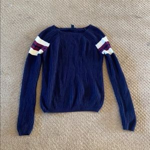 Navy sweater with white stripes on sleeves